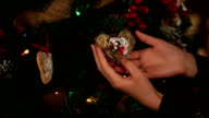 Nice feminine fragile hands holding the christmas toy. Close-up video