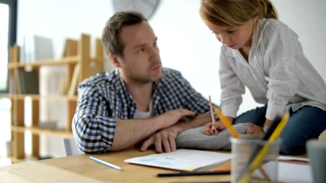 Nice little girl drawing with her father video