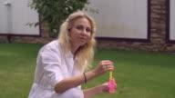 Nice mum plays outdoor video