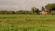 Nice shot of farmhouse in meadow video