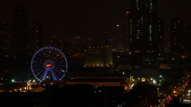 night bangkok cityscape rooftop traffic bay asiatique ferris whee panorama 4k thailand video
