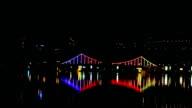 Night city bridge lights over the river video