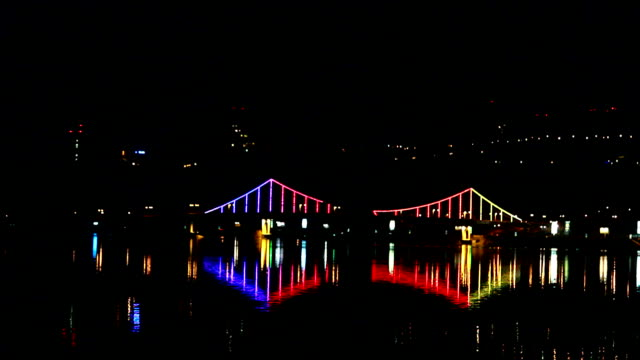 Night city bridge lights over the river video