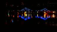 Night city bridge lights over the water video