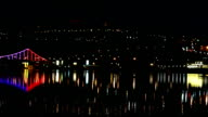 Night city lights over the river video