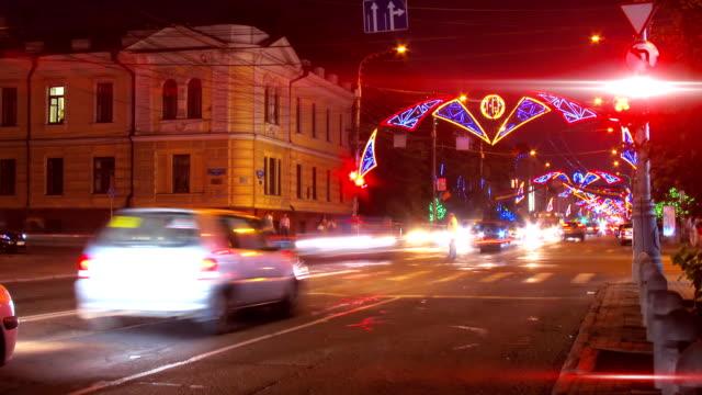 night city traffic on crossroad with festive illumination timelapse video