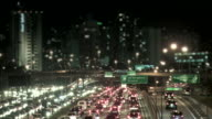 Night city traffic with defocused buildings in background video