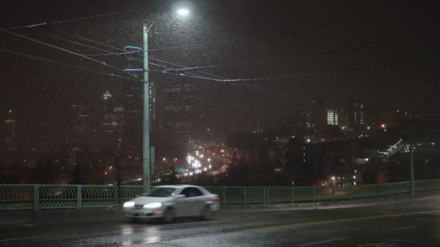 Night Cityscape of Bad Weather on Downtown Seattle, Washington with Snow Falling video