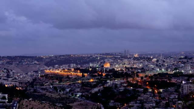 Night falls over Jerusalem city timelapse video