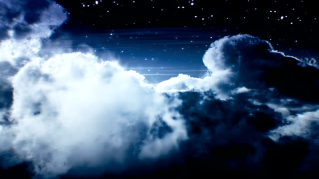 Night flight over clouds. Loop video
