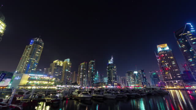 night illumination dubai marina famous dock panorama 4k time lapse united arab emirates video