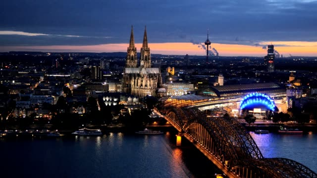 Night panning shot of Cologne Cathedral and Hohenzollern Bridge. Cologne, Germany. video