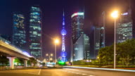 night scene of city road and modern buildings in shanghai time lapse 4k video