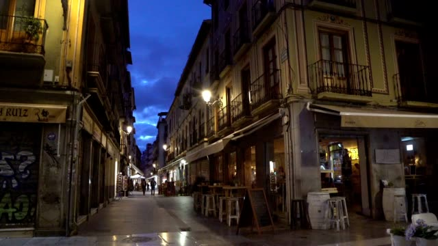 Night shot of a street near the main cathedral in the town center of Granada, Spain. video