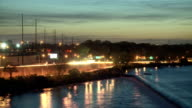 Night time traffic and river timelapse. video