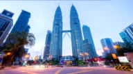 Night to day 4k time lapse of junction traffic light in front of Suria KLCC with Petronas Towers. video