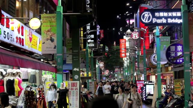Night traffic and crowd people of in ximending Taipei, Taiwan video