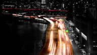Night Traffic on the Embankment. Slow Motion. Tinted video