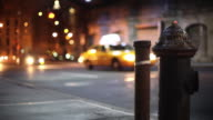Night traffic with fire hydrant - shallow focus video