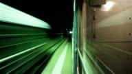 Night train departs from platform. Timelapse video