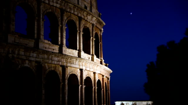Night view of the Colosseum amphitheatre in the centre of Rome video