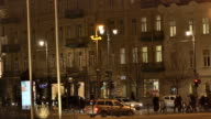 Night Vilnius. Passers-by on the avenue video