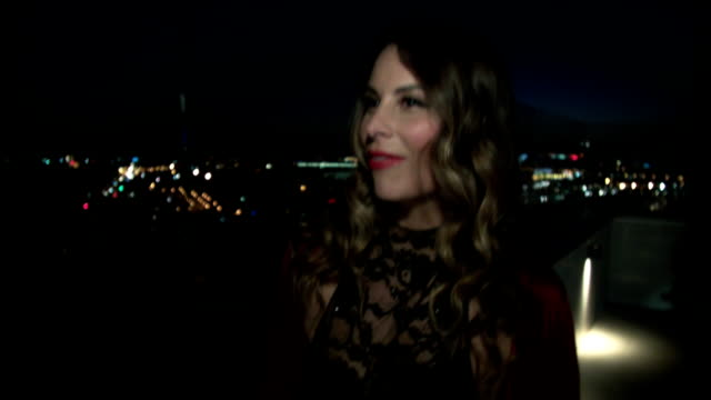 Nightlife - Beautiful Woman at balcony at city downtown video