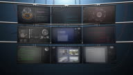 Nine Video Screen Monitors Animate with Data and Surveillance video