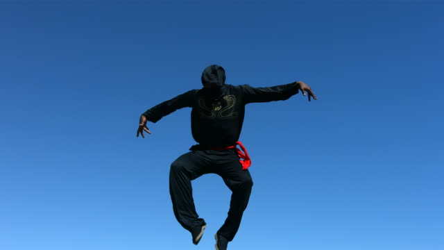 Ninja jumps in air, slow motion video