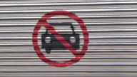 No parking sign graffiti spray on garage metal door video