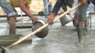 Non identify Construction workers pour concrete mix from cement mixer. video