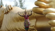 Nora dance in front of Big Buddha video