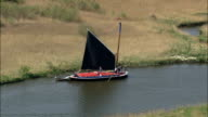 A Norfolk Wherry On the River Bure  - Aerial View - England, Norfolk, North Norfolk District, United Kingdom video
