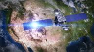 North America. Telecommunication satellite orbiting Earth. video