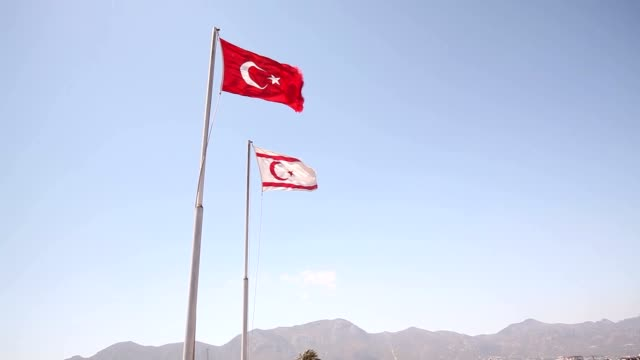 Northern Cyprus, the flag of the Republic of Northern Cyprus against the blue sky and the sea video