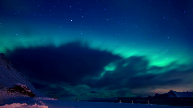 Northern Lights and Clouds in the Night Sky of Lofoten. Time Lapse video