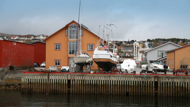 Norwegian fishing village. Colorful wooden houses on the coast video