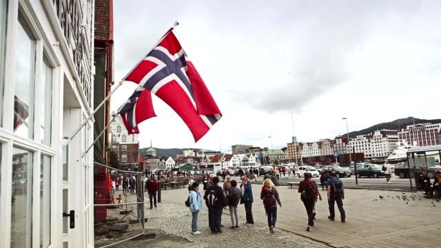 Norwegian flag at Bryggen in Bergen video
