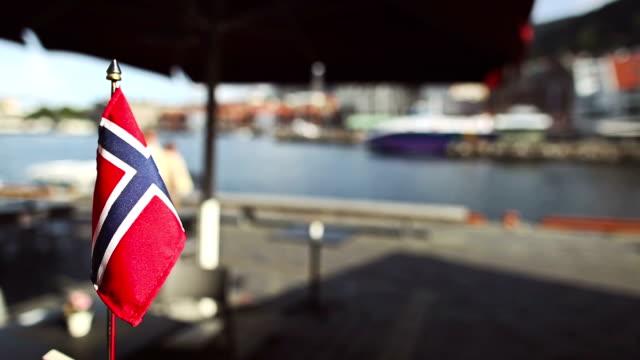 Norwegian flag at the harbor in Bergen video