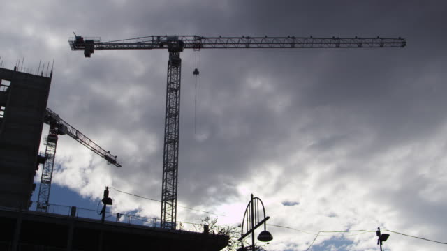 November 18 2016, Birmingham/UK: Silhouette Of Tower Cranes On Construction Site video
