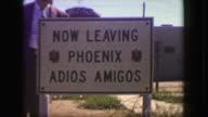 1949: Now leaving Phoenix adios amigos roadside travel tourist sign. video