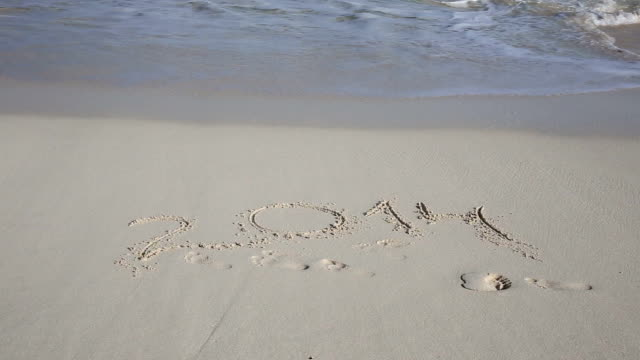 Number 2014 wash away on tropical beach video