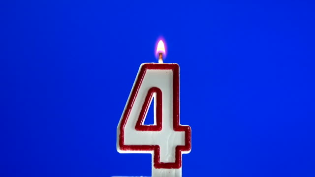 Number 4 - four birthday candle burning video