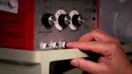 Nurse adjusts an old machine video