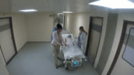 POV Nurse and doctor pushing stretcher with patient along hallway video