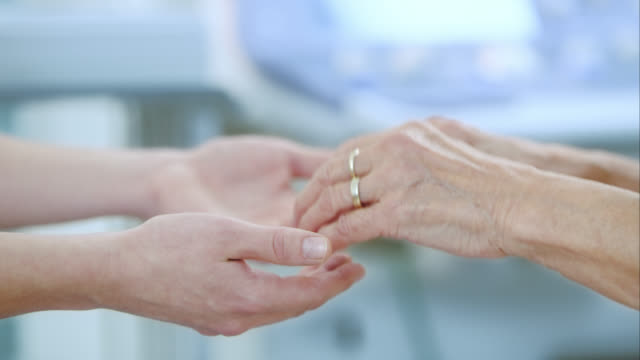 Nurse and patient holding hands video