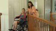 Nurse Assisting Wheelchair Bound Female in Home video