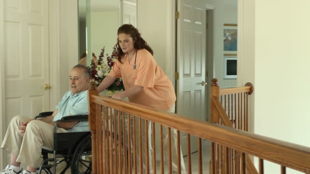 Nurse Assisting Wheelchair Bound Male in Home video