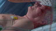 DS Nurse bathing a senior ICU patient at night video