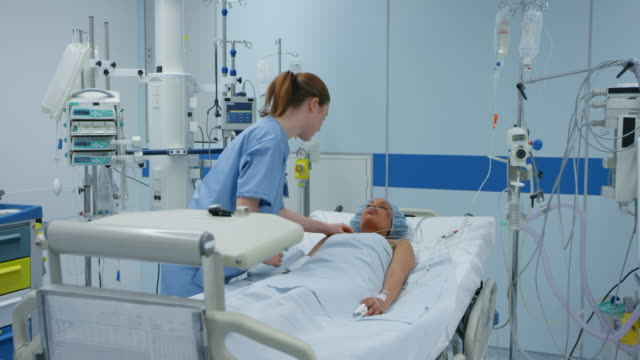 DS Nurse checking an African-American patient in the intensive care video